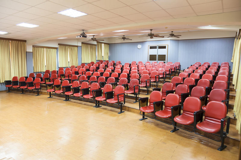 Interior of conference hall with red chairs royalty free stock photo
