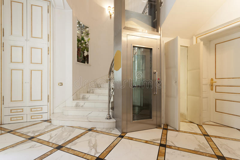 Interior of a corridor with passenger lift.  stock photography