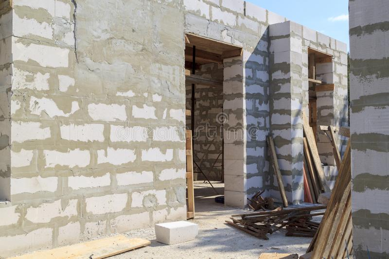 interior of a country house under construction. Site on which the walls are built of gas concrete blocks with wooden formwork stock image