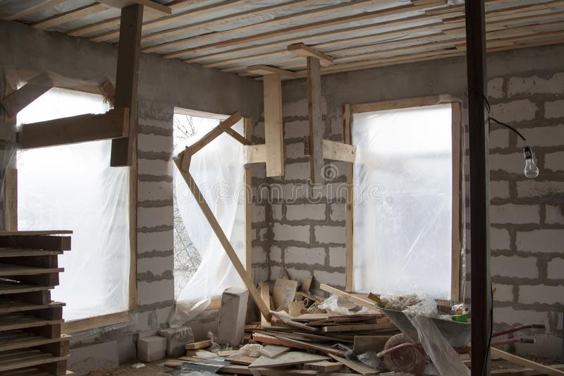 interior of a country house under construction with trim plywood. Site on which the walls are built of gas concrete blocks with stock images