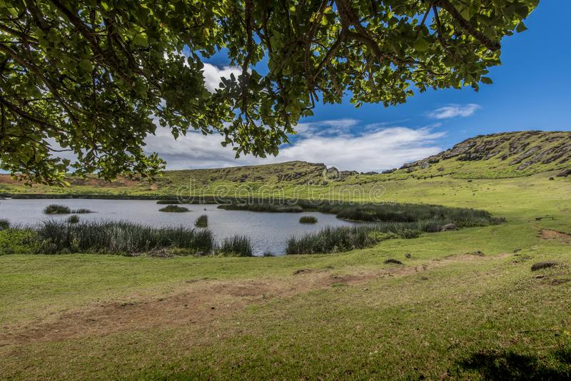 Interior of the crater of the Rano Raraku volcano with underground moais. Path on the hill of the moais of the Rano Raraku volcano where all the moai were royalty free stock photography