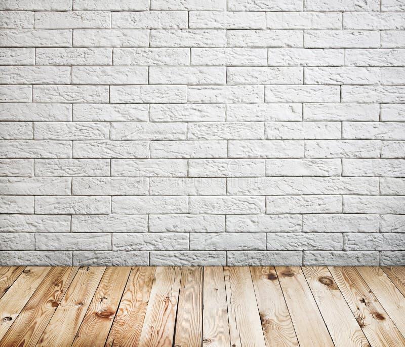 Interior da sala com a parede de tijolo branca fotos de stock