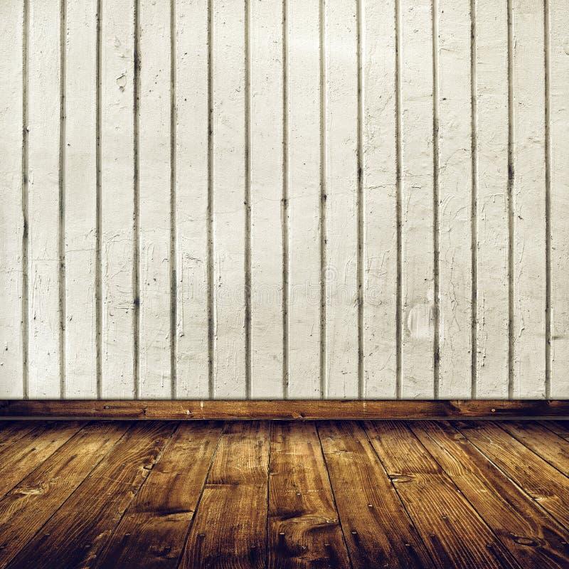 Interior da sala com a parede de tijolo branca e o assoalho de madeira fotografia de stock