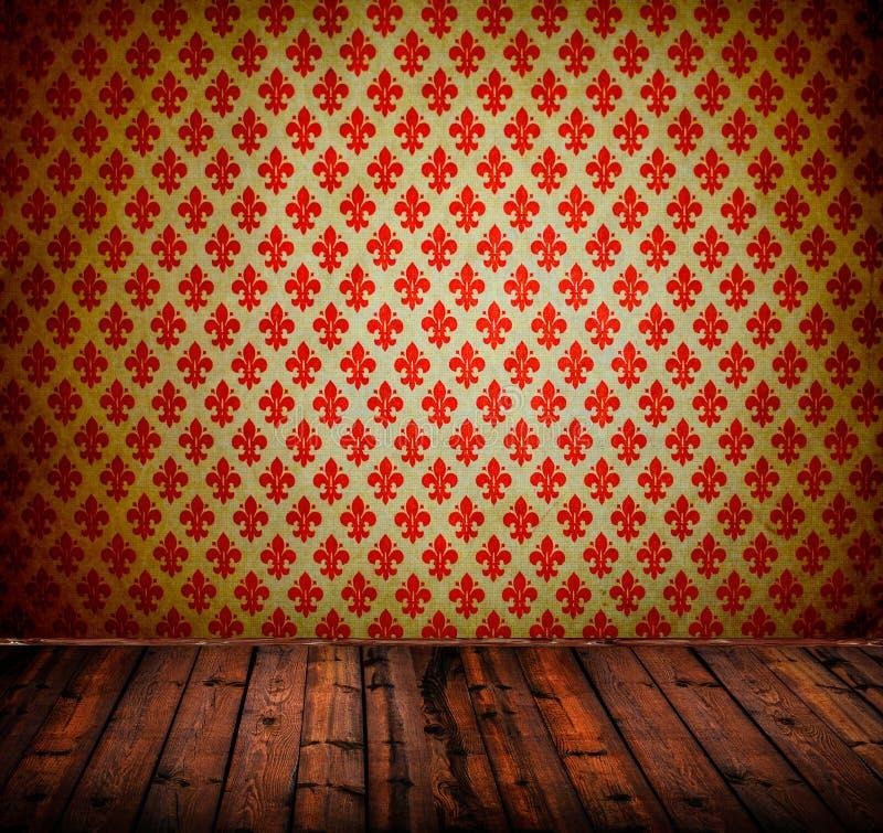 Interior da sala do vintage com o papel de parede de madeira do assoalho e do damasco fotos de stock royalty free