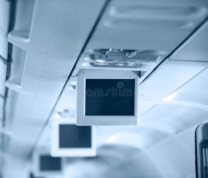 Interior de los aviones comerciales foto de archivo