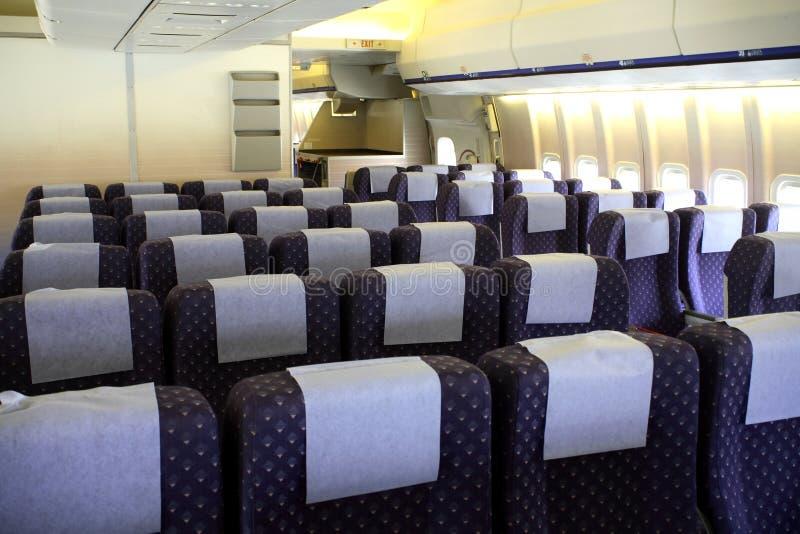 Interior de los aviones de pasajero imágenes de archivo libres de regalías
