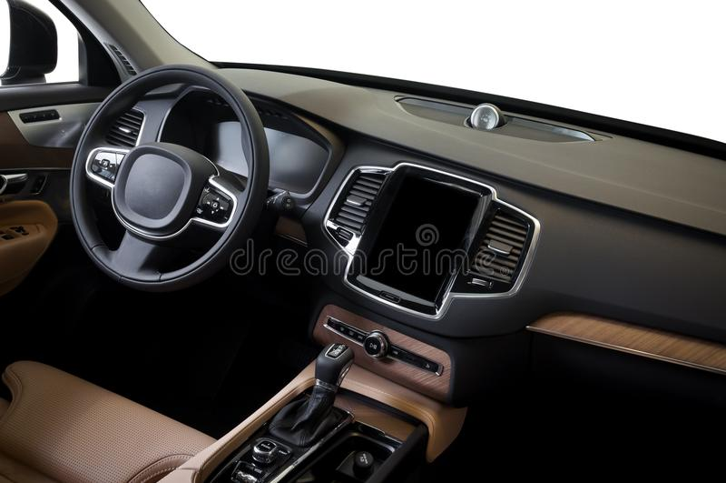 Interior de lujo moderno del coche del prestigio, tablero de instrumentos, volante fotografía de archivo libre de regalías