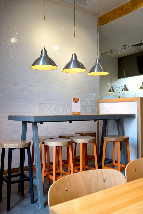 Interior decoration of cafe. Restaurant, fast food in modern style royalty free stock photography