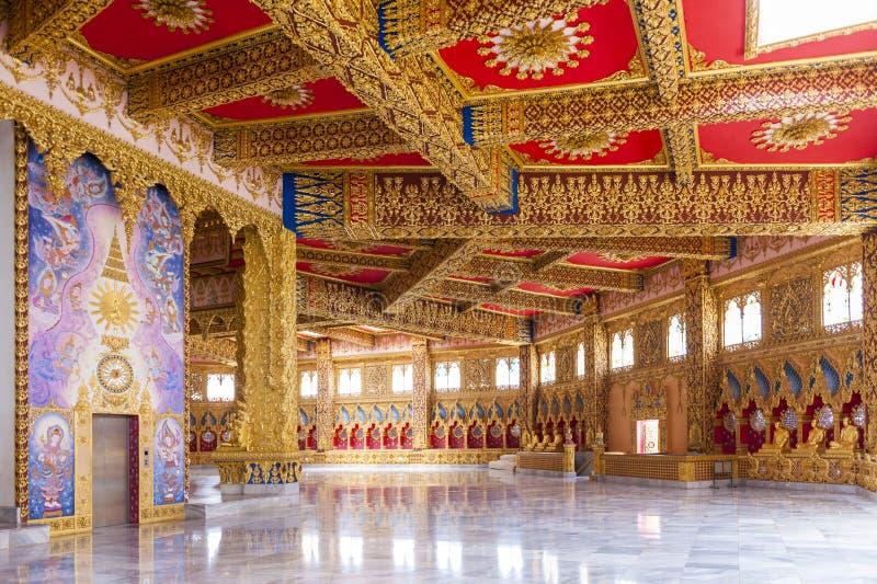 Interior decoration inside Phra Maha Chedi Chai Mongkol in Roi Et province, northeastern Thailand. Interior decoration elaborated in golden theme inside Phra stock photos
