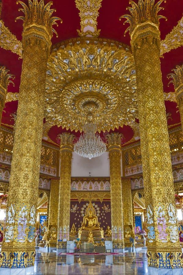 Interior decoration inside Phra Maha Chedi Chai Mongkol in Roi Et province, northeastern Thailand. Interior decoration elaborated in golden theme inside Phra stock image