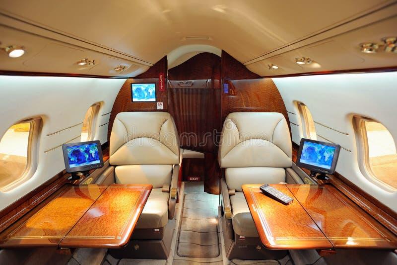 Interior del aeroplano del jet imagenes de archivo