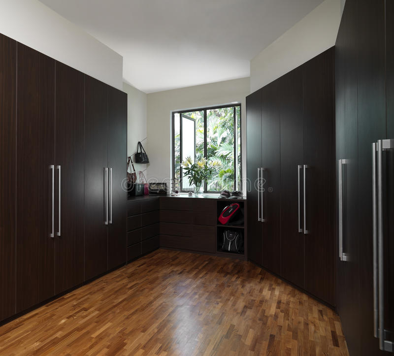 Interior design. Walk in wardrobe design with parquet flooring royalty free stock photography