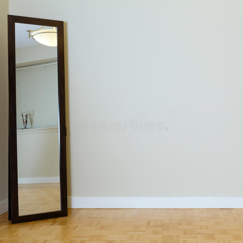 Interior design. Empty Living Room with mirror in a new apartment royalty free stock image