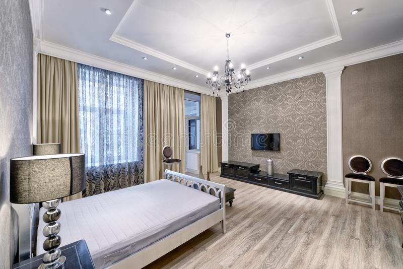 Interior design beautiful bedroom in luxury home. Russia, Moscow - modern designer renovation in a luxury building. Stylish bedroom interior with double bed royalty free stock photo