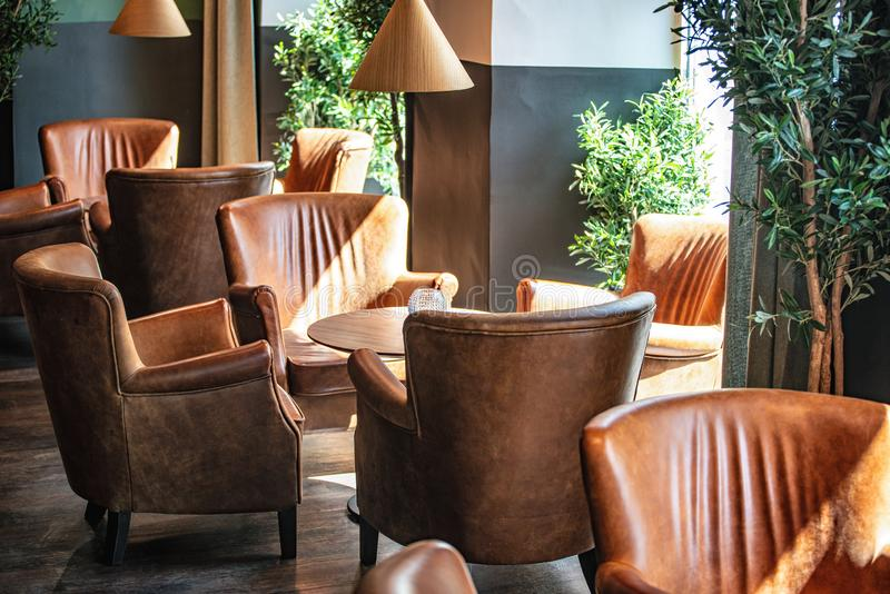 Interior design with Brown leather seats and sun shining from the windows royalty free stock photography