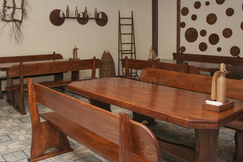 Interior design of the cafe with wooden tables and chairs royalty free stock images