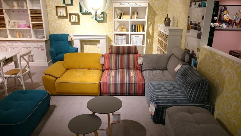 Interior design: colorful couch and coffee table. Interior design for modern homes at a furniture producer showroom stock photos