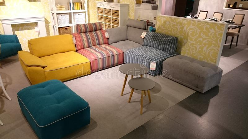 Interior design: colorful couch and coffee table. Interior design for modern homes at a furniture producer showroom stock photography