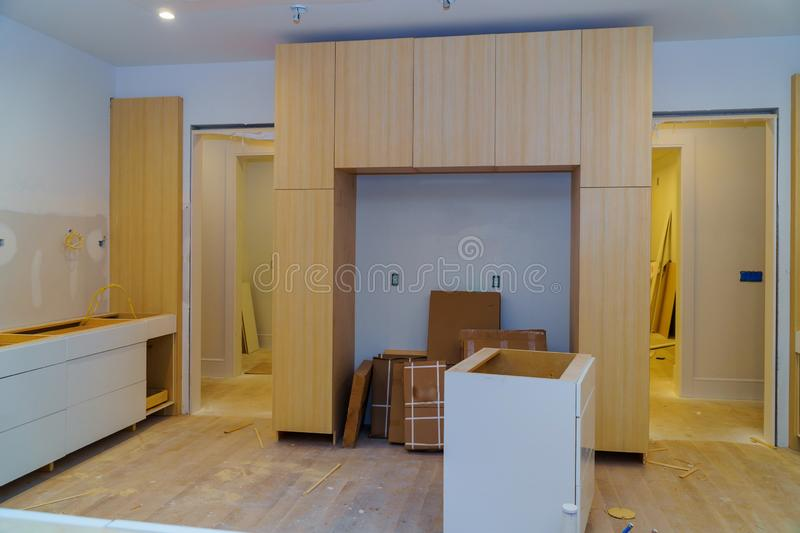 Interior design construction of a kitchen drawers of kitchen. Interior design construction of a kitchen drawers fronts assembling kitchen furniture, cabinet stock photos
