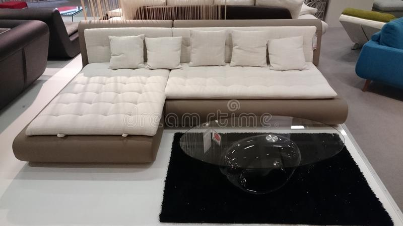 Interior design: couch and coffee table. Interior design for modern homes at a furniture producer showroom stock photography