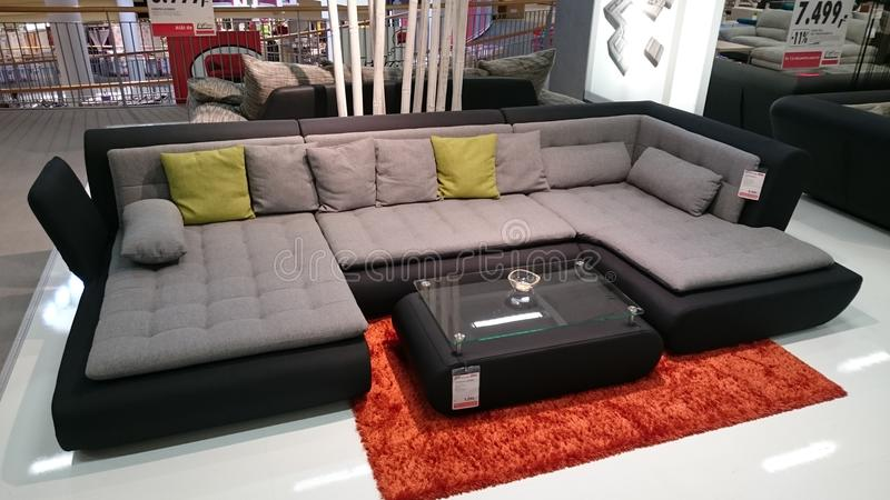 Interior design: couch and coffee table. Interior design for modern homes at a furniture producer showroom stock photo