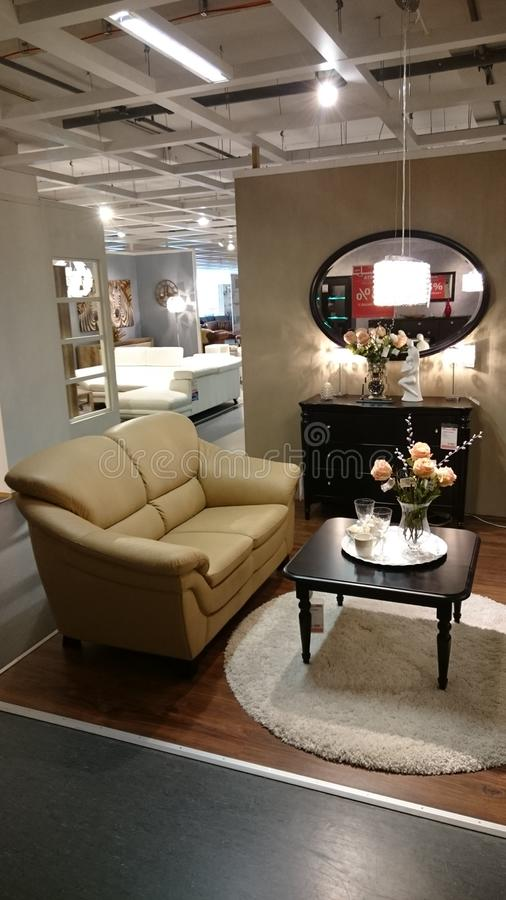 Interior design: couch and coffee table. Interior design for modern homes at a furniture producer showroom stock image