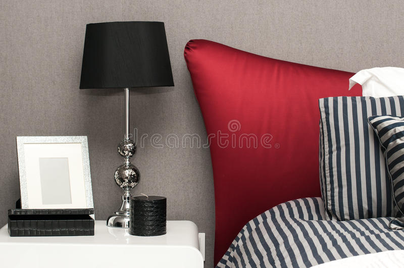 Interior design detail of a luxury hotel room. Details of the bed royalty free stock photo