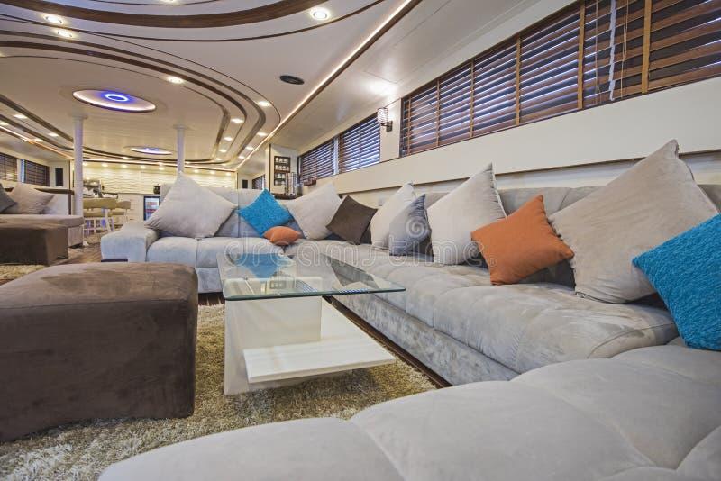 Interior of large salon area of luxury motor yacht royalty free stock photo