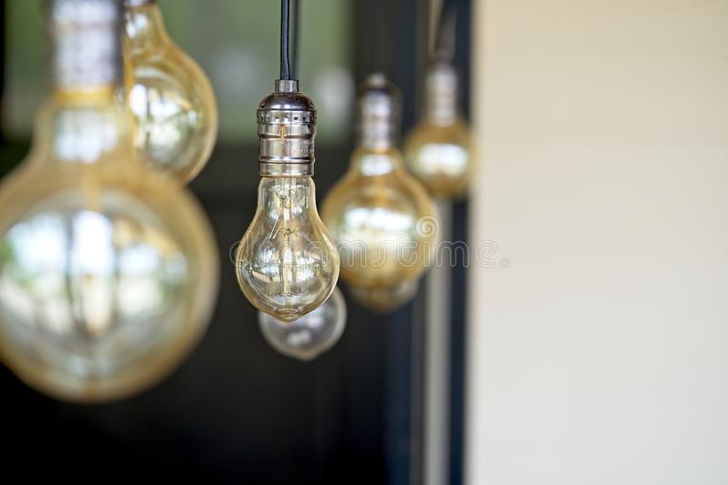 Interior design of lamp.Decorative antique style filament light bulbs hanging. Lighting lamp under the ceiling royalty free stock photos
