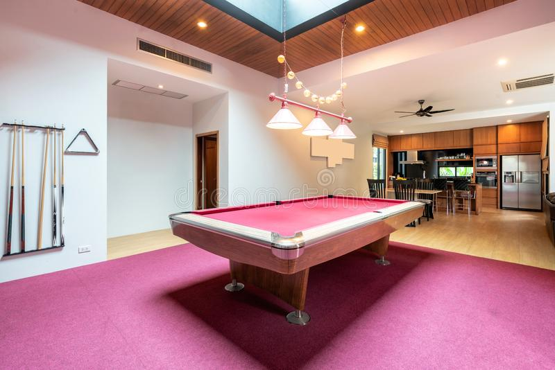 Interior design living room with pink snooker table in the house royalty free stock photos