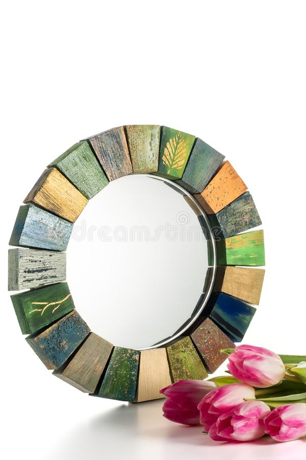 Interior design mirror handmade in wooden frame with bouquet of spring tulips. Interior design mirror handmade in wooden frame with painted cracks aged paints royalty free stock photo