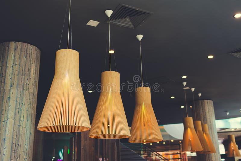 Interior design of modern hotel lobby. Row of suspended lamps. Shopping center hall. Business center hallway. stock photography