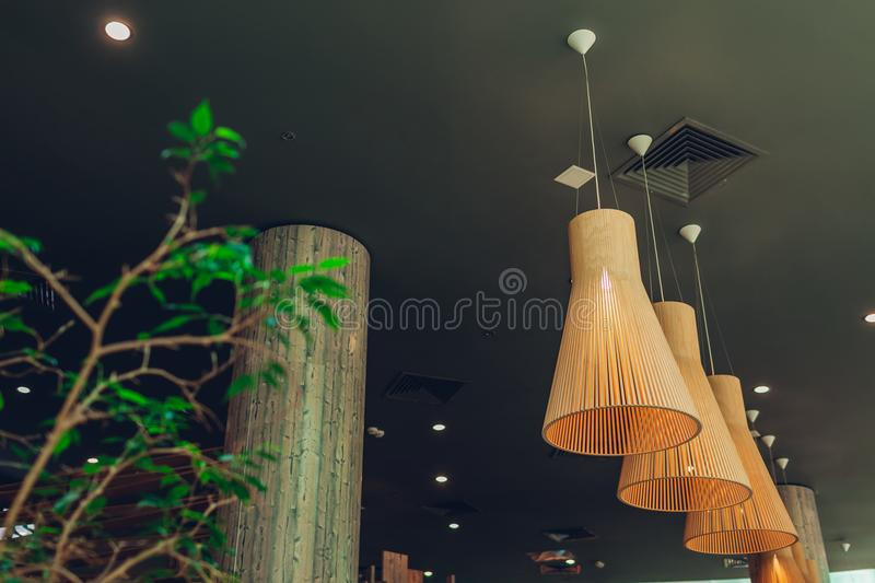 Interior design of modern hotel lobby. Shopping center hall. Business center hallway. Row of suspended lamps and plant stock images