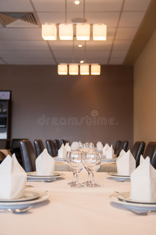 Interior of modern restaurant , empty glass on table. stock photos