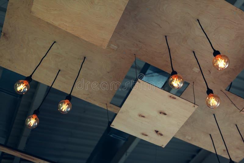 Interior design of modern restaurant ceiling. Steam-punk, pop-art, high-tech, loft design. Shopping center decoration royalty free stock images