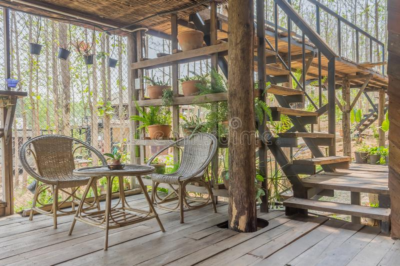 Interior Design Room of Home Stay with Rattan Chair and Table and Stair stock photo