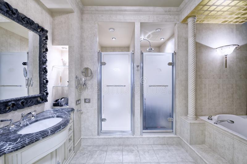 Interior design stylish bathroom luxury house. Black-and-white marble in the interior of a modern bathroom in a luxury apartment royalty free stock images
