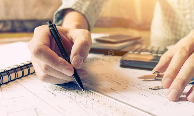 Interior designer or architect reviewing blueprints and holding royalty free stock photos