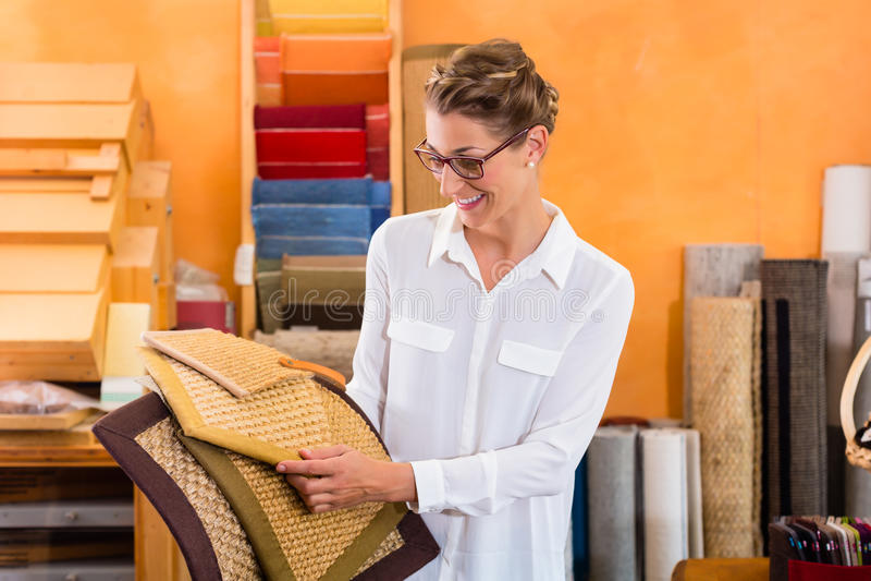 Interior Designer buying floor mats stock photos
