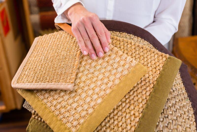 Interior Designer buying floor mats royalty free stock photo
