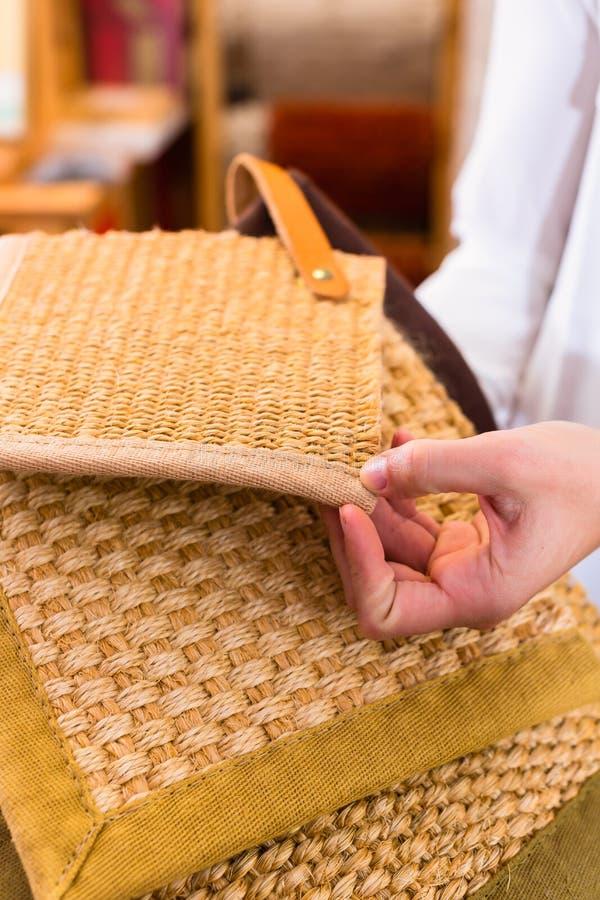 Interior Designer buying floor mats royalty free stock images