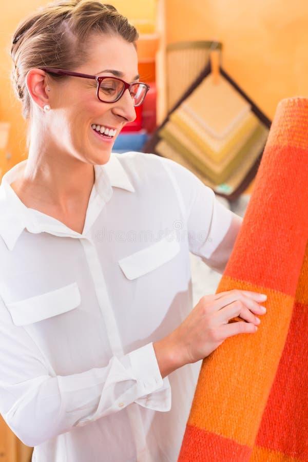 Interior Designer buying rug or carpeting royalty free stock photography