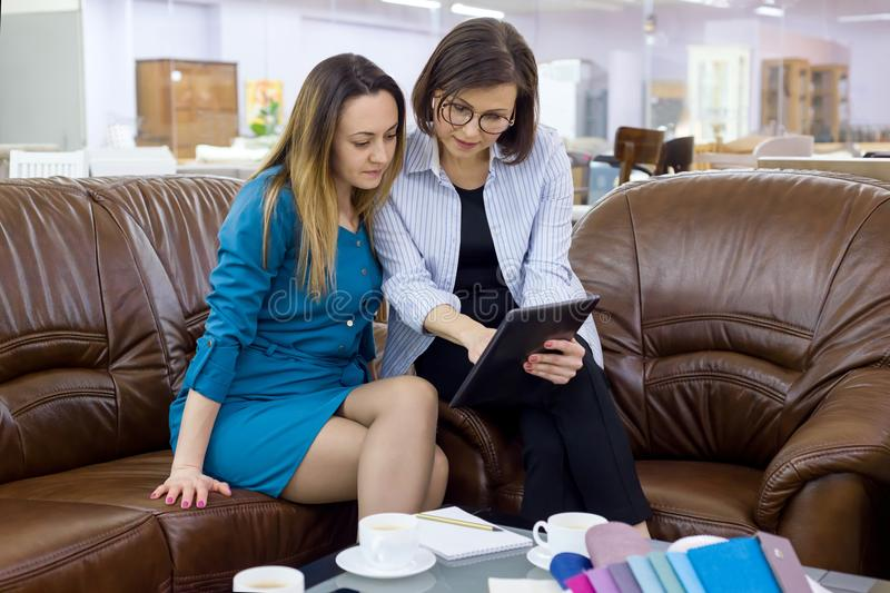 Interior designer and client-adult woman stock image