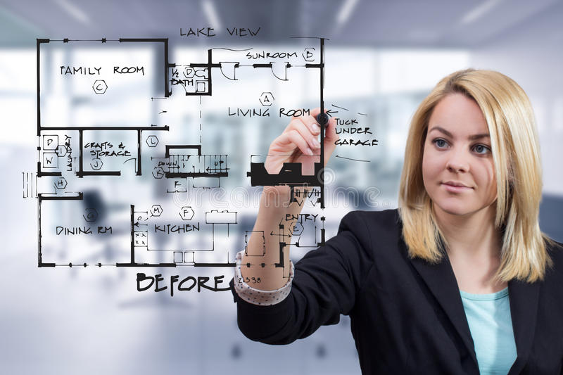 Interior designer drawing interior blueprint sketch at office royalty free stock images
