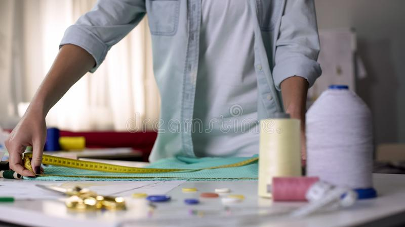 Interior designer looking for inspiration, working with fabric and accessories royalty free stock image