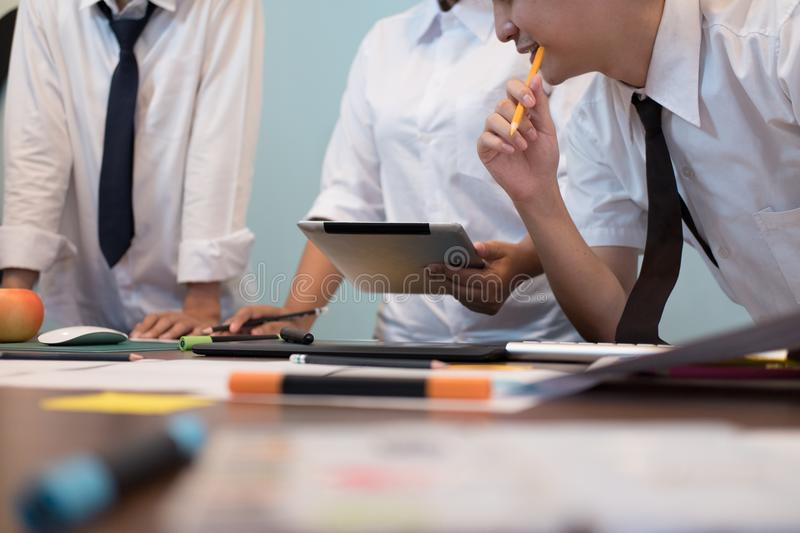 interior designer working with graphic tablet at workplace. artist discussing design and idea at office. business people royalty free stock photography