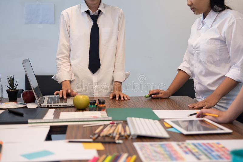 interior designer working with graphic tablet at workplace. artist discussing design and idea at office. business people stock photography