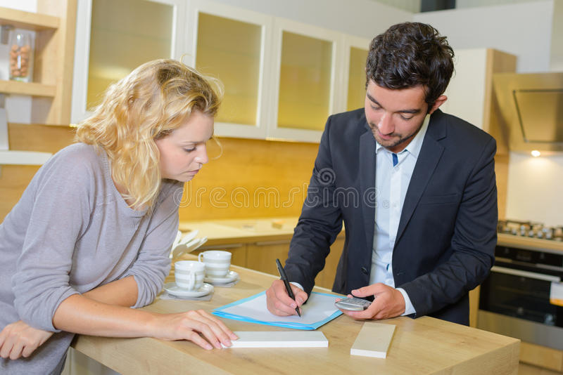 Interior designer writing estimate royalty free stock photography