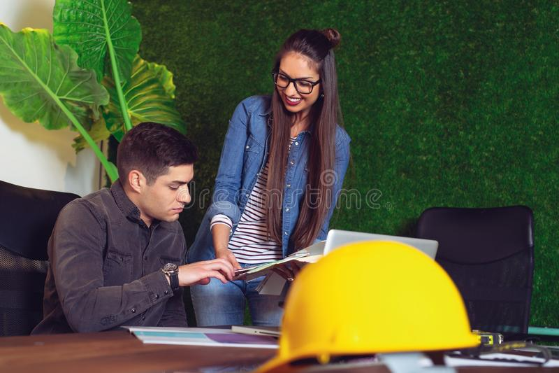 Interior designers choosing wall color for their new project. - Image. Young Interior designers choosing wall color for their new project. - Image royalty free stock photo