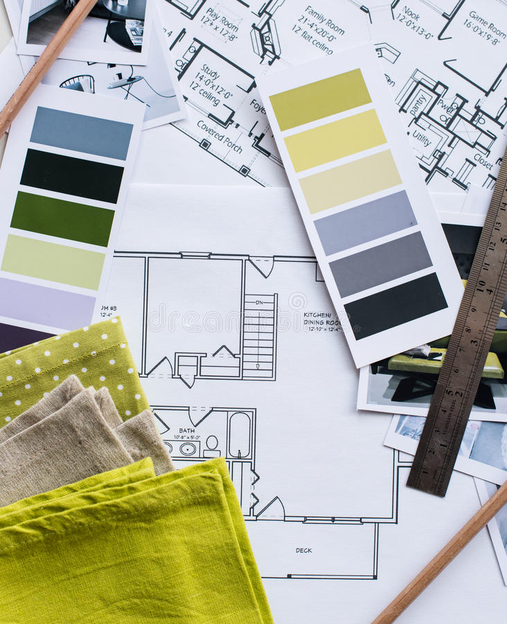 Interior designers working table. Interior designer's working table, an architectural plan of the house, a color palette, furniture and fabric samples in yellow royalty free stock images